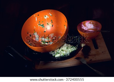 pile unharvested and washed dirty dishes and garbage in the morning on the dining table - stock photo