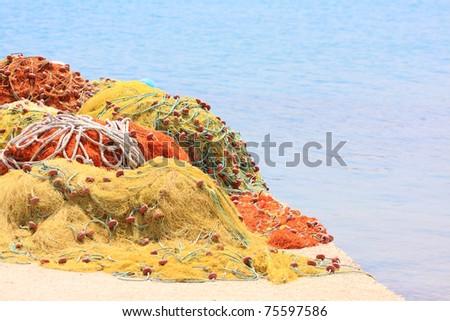 Pile yellow and orange  fishing net background - stock photo