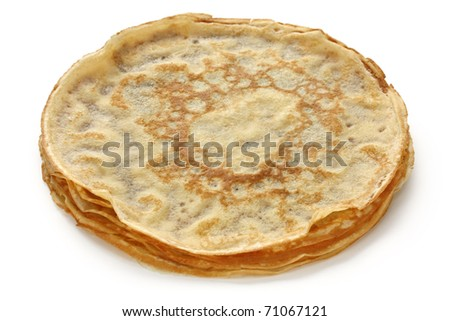 piled crepes on white background