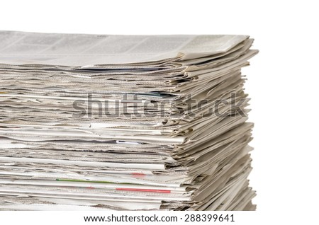 Piled newspapers on a white background - stock photo