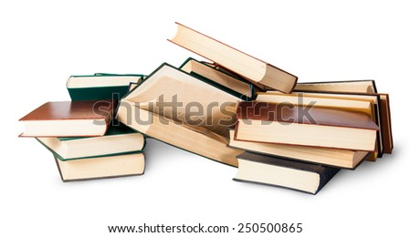 Piled on a bunch of old books isolated on white background - stock photo