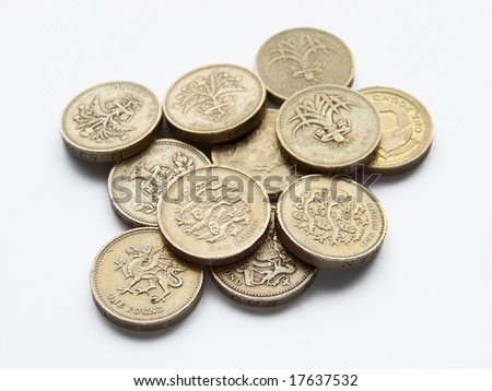 piled one pound coins - stock photo