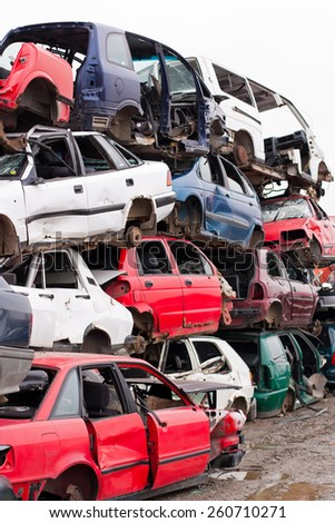 Piled up destroyed cars in the junkyard.