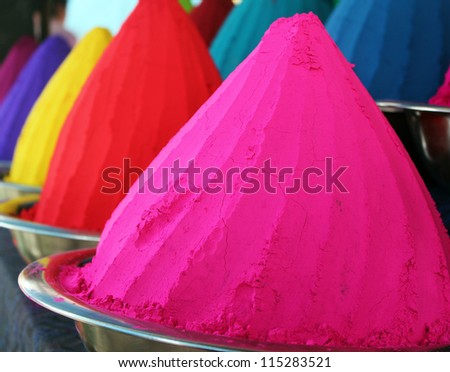 Piles and mounds of colorful dye powders for holy festival & other religious purposes being sold in indian market. These dry powders are in great demand in India and used for rangoli, holi, etc - stock photo