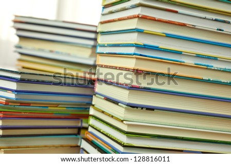 Piles of books on white background