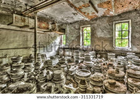 Piles of clay molds at an abandoned ceramics factory, HDR - stock photo