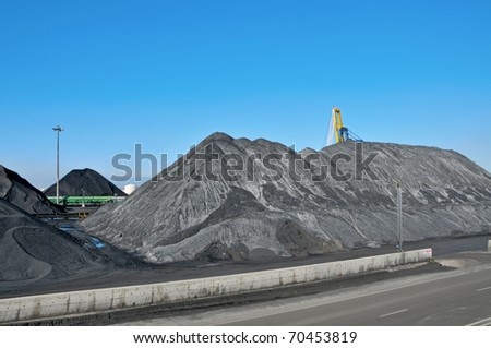 piles of coal at the facilities of a coal industry - stock photo