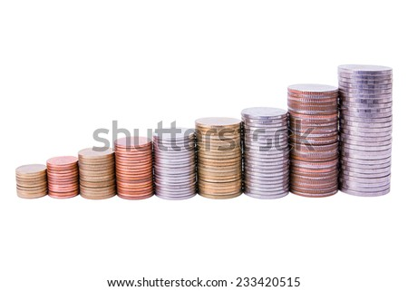 Piles of coins forming a growing graph isolated on white background - stock photo
