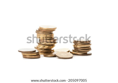 Piles of coins isolated on white background - stock photo