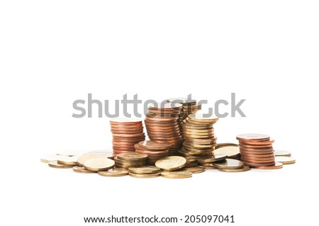 Piles of coins isolated on white table and background