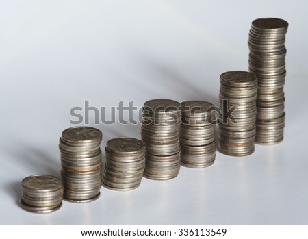Piles of coins of different height  - stock photo