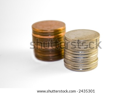 piles of coins - pennies and ten pence - stock photo