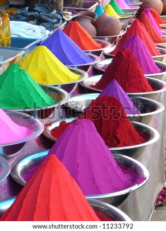Piles of colored dyes in market, Mysore, India - stock photo
