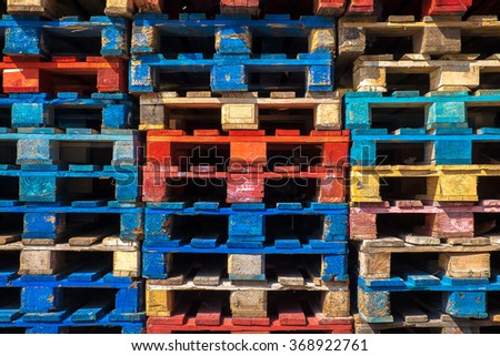 Piles of colored wooden pallets  - stock photo