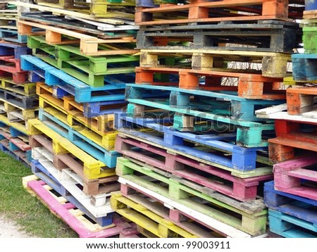 Piles of colorful wooden pallets - stock photo