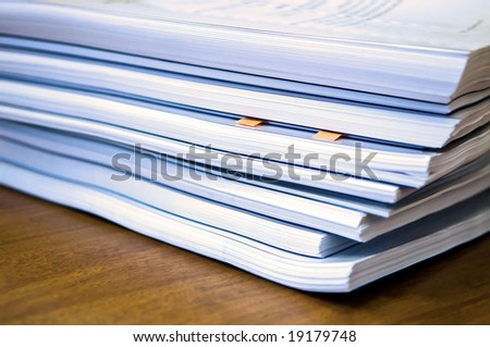 Piles of documents lying on a table - stock photo