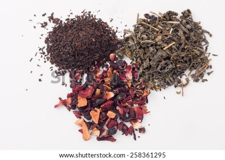 piles of dry green, black and fruit tea leaves - stock photo