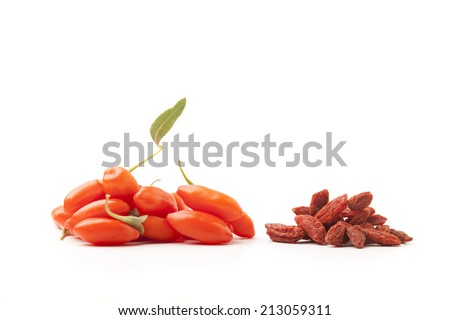 piles of fresh and dry goji berry on white background - stock photo