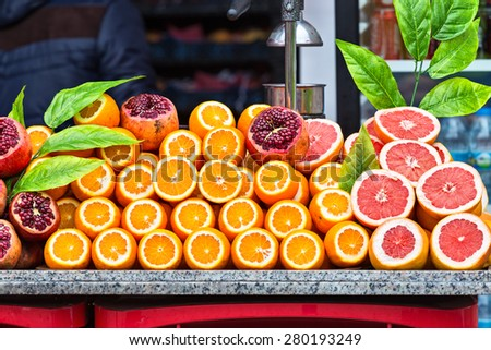Piles of fresh fruits ready to be transformed in juice on the Istanbul streets - stock photo
