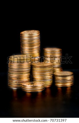 Piles of gold coins on a black background