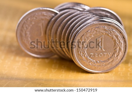 piles of golden coins on white background, polish zloty coins