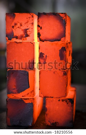 piles of hot iron blocks in foundry. Narrow focus - stock photo
