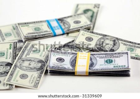 piles of minature money  represents the world wide shrinking economy isolated on white - stock photo