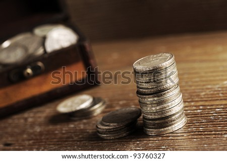 piles of old coins on wooden table