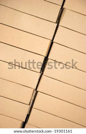 piles of paper boxes with goods in storage - stock photo