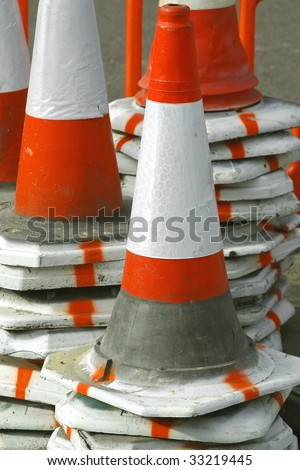 piles of reflective traffic safety cones for highway maintenance - stock photo