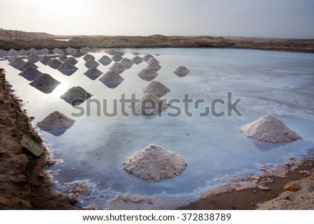 Piles of salt gathered in Santa Maria salt pits Cabo Verde, Sal Island - stock photo