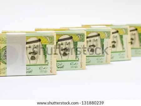piles of Saudi money isolated on white background