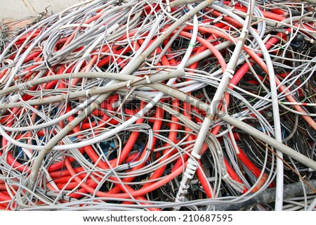 piles of scrapped electrical cables in electrical discharge - stock photo