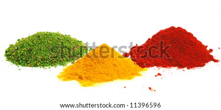 Piles of spices. Parsley, oregano, red paprika and curcuma