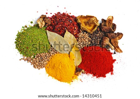 Piles of spices: parsley, red paprika, whole black pepper, white coriander, curcuma, laurel leaves and dry porcini mushrooms. - stock photo
