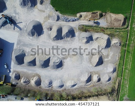 Piles of stones on building site gravel-pit - stock photo