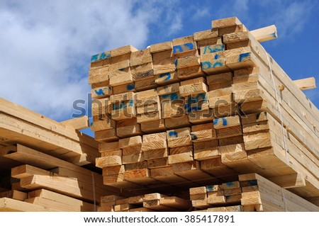 Piles of  timber cut from Pinus radiata wait their turn for despatch from the sawmill - stock photo