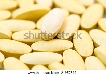 Piles of Vitamin C tablet macro closeup - stock photo