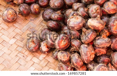piles of water chestnut in a market stall, closeup of pictures. - stock photo