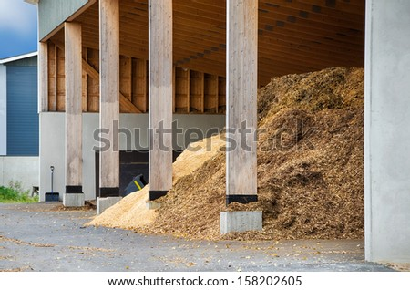Piles of wood chips waiting to be turned into bio fuel for heating  - stock photo
