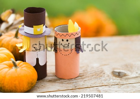 Pilgrim and Indian decorations on a wooden table. - stock photo