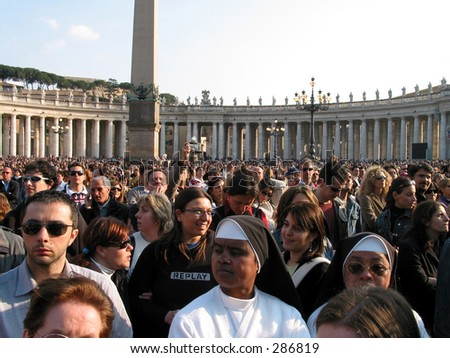 Pilgrims praying and supporting the pop at st. peters square a day before he died