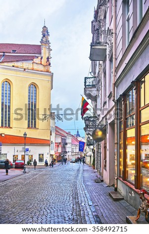 Pilies Street in the Old Town of Vilnius in Lithuania in winter - stock photo