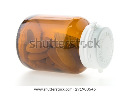 Pill bottle isolated on white background - stock photo