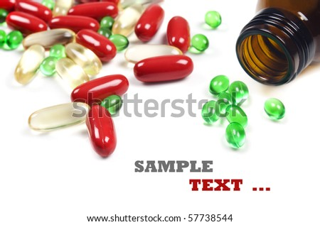 Pill bottle with red and green pills - on a white background with space for text - stock photo