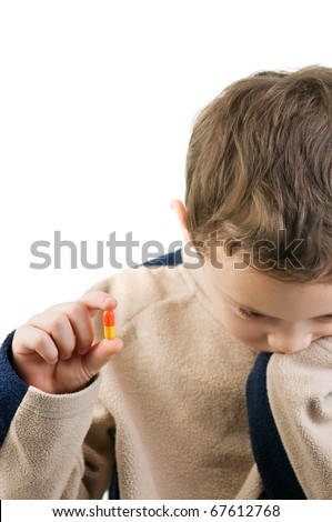 pill in child hand isolated - stock photo