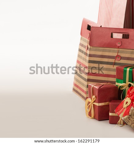 Pillar of boxes with presents wrapped in red paper on white background - stock photo