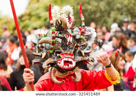 Pillaro, Ecuador - 06 February 2012: People Disguised As Devils Dancing For The Diablada In Pillaro On February 06, 2012 - stock photo