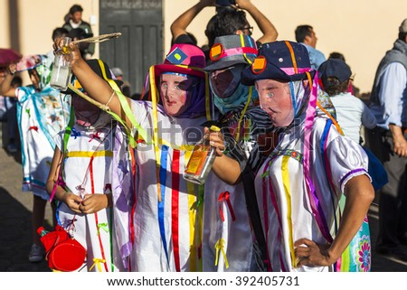 Pillaro, ECUADOR - FEBRUARY 6, 2016: Unidentified people wearing costumes and masks in diabladas of Pillaro - stock photo
