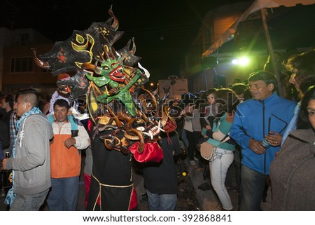 Pillaro, ECUADOR - FEBRUARY 6, 2016: Unknown locals dressed up participating in the Diablada, popular town celebrations with people dressed as devils dancing in the streets - stock photo